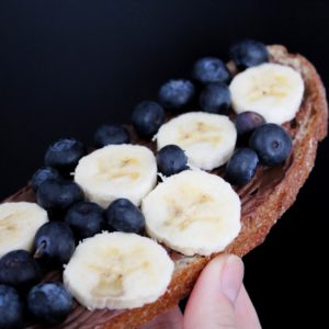 Wholemeal bread with peanut butter, berries and banana